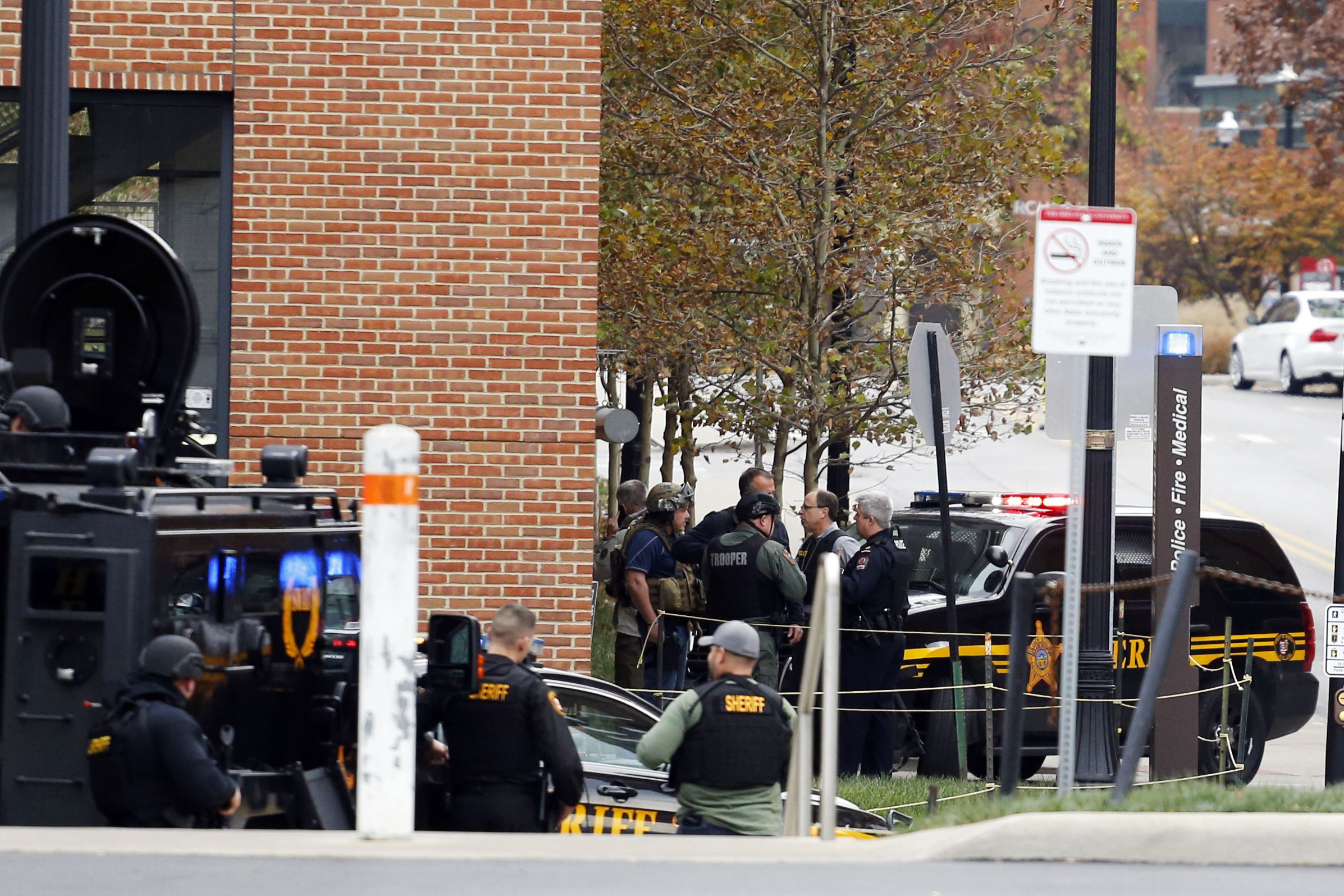 Law enforcement officers work around a parking garage on the campus of The Ohio State University Monday, Nov. 28, 2016, in Columbus, Ohio. (AP Photo/Jay LaPrete)