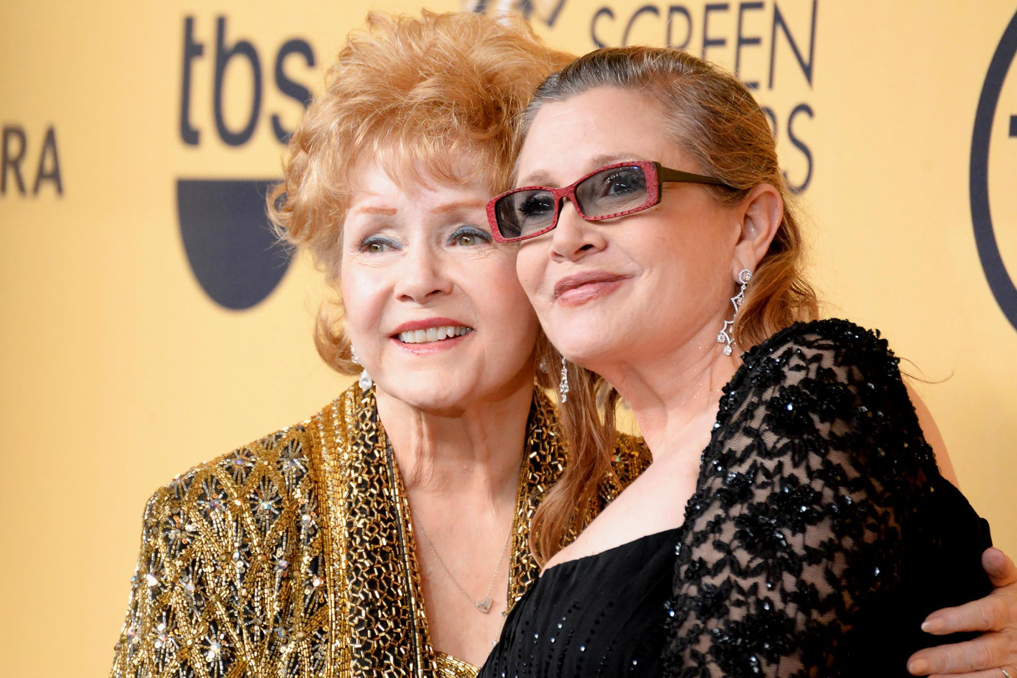 LOS ANGELES, CA - JANUARY 25:  Actresses Debbie Reynolds (L) and Carrie Fisher pose in the press room at the 21st Annual Screen Actors Guild Awards at The Shrine Auditorium on January 25, 2015 in Los Angeles, California.  (Photo by Jeff Kravitz/FilmMagic)